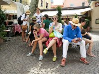 Family in Market Square, Stresa, Italy.